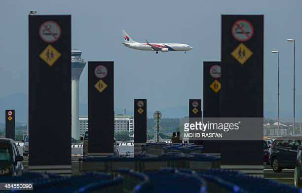 A Malaysia Airlines Boeing 737800 passenger aircraft makes its final approach for landing at the Kuala Lumpur International Airport in Sepang on...