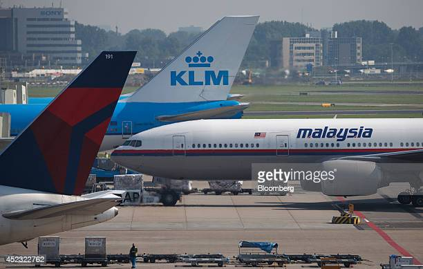 A Malaysia Airlines Boeing Co 777200 passenger aircraft right bound for Kuala Lumpur stands between aircraft operated by Air FranceKLM Group center...