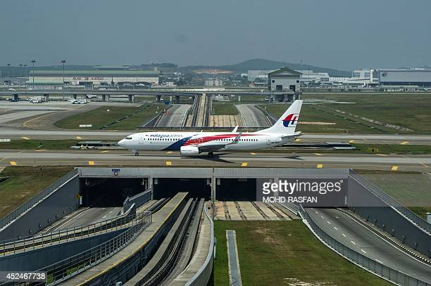 A Malaysia Airlines plane is seen on the tarmac at Kuala Lumpur International Airport in Sepang on July 21 2014 Malaysia Airlines said it would offer...