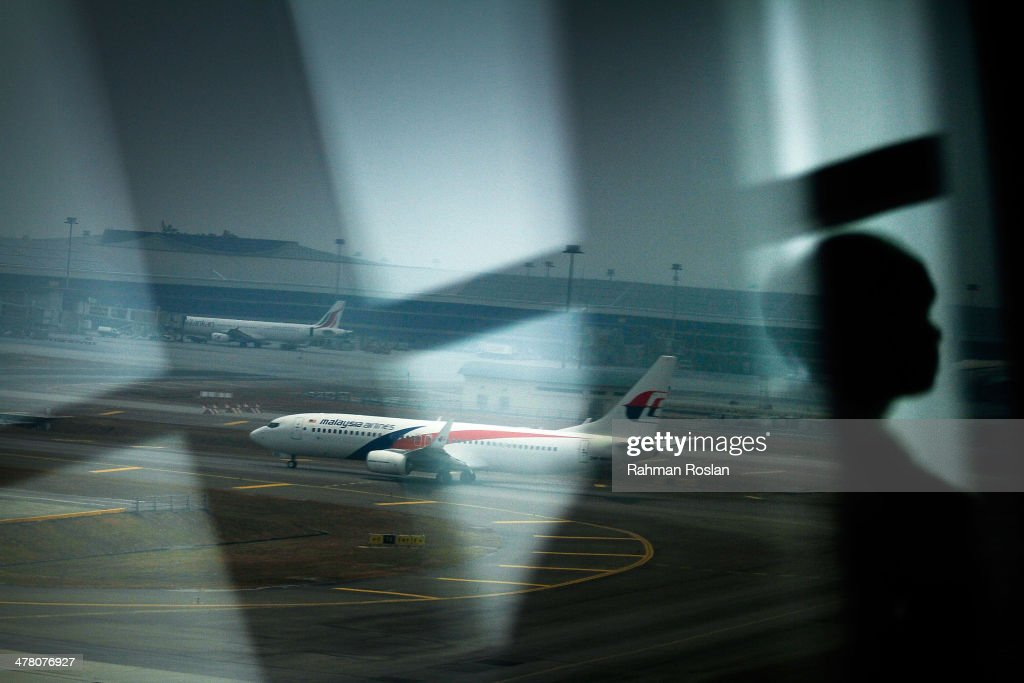 A Malaysia Airlines plane is seen on the tarmac at Kuala Lumpur International Airport on March 12, 2014 in Kuala Lumpur, Malaysia. Officials have expanded the search area for missing Malaysia Airlines flight MH370 beyond the intended flight path to include the west of Malaysia at the Straits of Malacca as new information surfaces about the time Subang air traffic control lost contact with the aircraft. The flight carrying 239 passengers from Kuala Lumpur to Thailand was reported missing on the morning of March 8 after the crew failed to check in as scheduled.