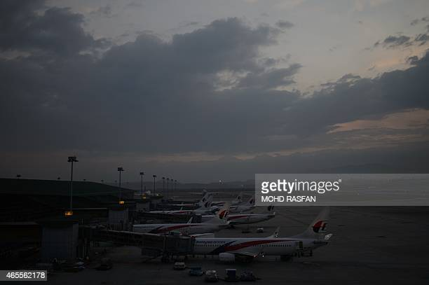 Malaysia Airlines planes are seen at departure gates at Kuala Lumpur International Airport in Sepang on March 8 2015 Malaysia's transport minister...