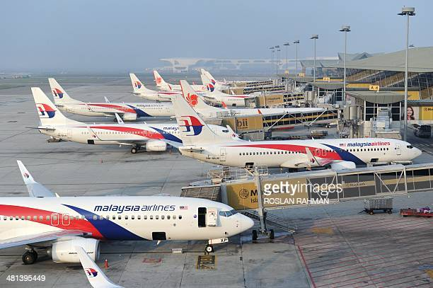 Malaysia Airlines planes parked at the terminal in Kuala Lumpur Intenational Airport in Sepang on March 30 2014 Ship and plane crews on March 29...