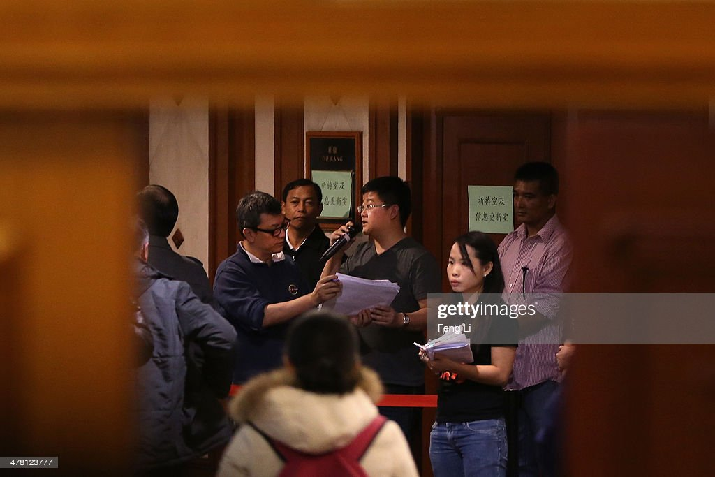 Malaysia Airlines staff arrange organise relatives of passengers onboard Malaysia Airlines flight MH370 as they line up to receive a special condolence payment of 31,000 CNY (almost 5,000 USD) at Lido Hotel on March 12, 2014 in Beijing, China. Officials have expanded the search area for missing Malaysia Airlines flight MH370 beyond the intended flight path to include the west of Malaysia at the Straits of Malacca as new information surfaces about the time Subang air traffic control lost contact with the aircraft. The flight carrying 239 passengers from Kuala Lumpur to Thailand was reported missing on the morning of March 8 after the crew failed to check in as scheduled.
