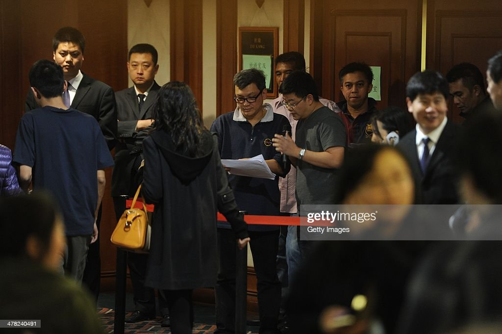 Malaysia Airlines staff organise relatives of passengers onboard Malaysia Airlines flight MH370 as they line up to receive a special condolence payment of 31,000 CNY (almost 5,000 USD) at the Metropark Lido Hotel on March 12, 2014 in Beijing, China. Officials have expanded the search area for the missing airliner beyond the intended flight path as new information surfaces about the time Subang air traffic control lost contact with the aircraft. The flight,carrying 239 passengers from Kuala Lumpur to Beijing, was reported missing on the morning of March 8 after the crew failed to check in as scheduled.