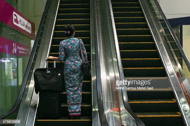 Malaysia Airlines stewardess is seen inside the Kuala Lumpur International Airport on June 2 2015 in Sepang Malaysia Chief Executive Officer and...