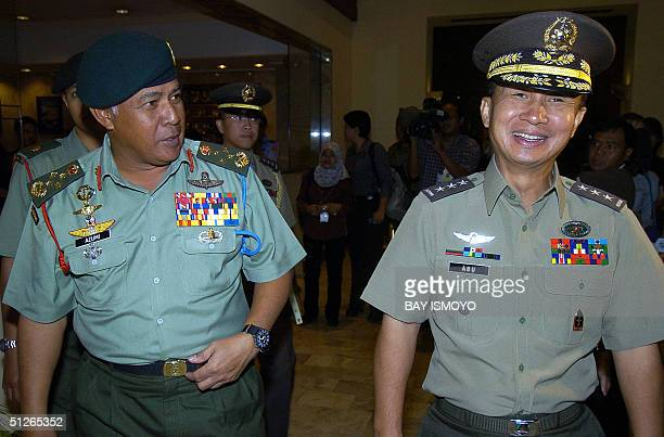 Malaysia and Philippine army chief General Mohd Azumi and Lt General Efren L Abu share a light moment after a meeting with Indonesian military chief...