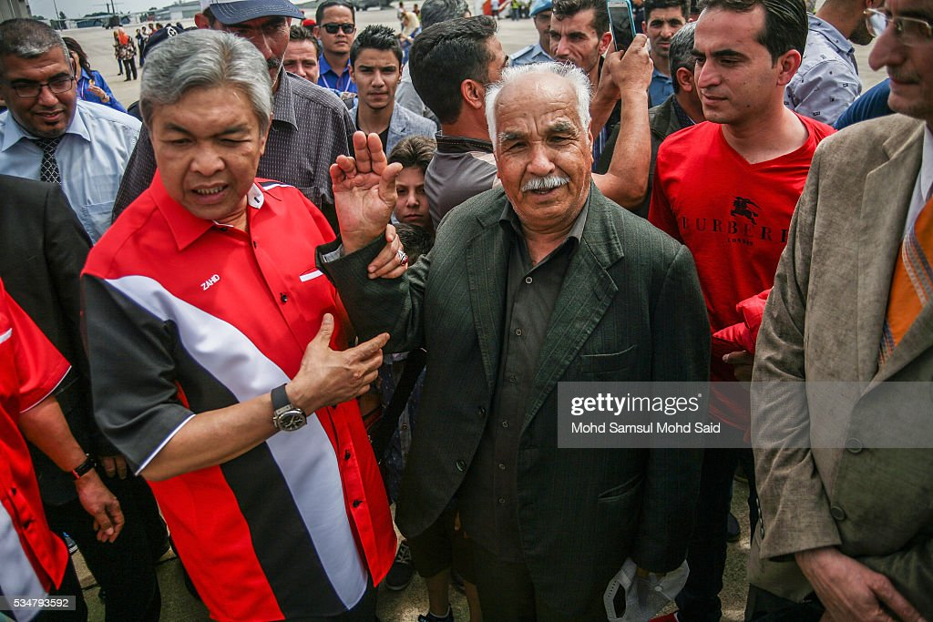 Malaysia Deputy Prime Minister Ahmad Zahid Hamidi welcomes Syrian migrants, from the Bekka Valley refugee camp in Lebanon, at the Royal Malaysian Air Force (RMAF) Base on May 28, 2016 in Subang Jaya, Malaysia. Malaysia has received almost 68 Syrian immigrants that have been selected to join this migrant program. Prime Minister Najib Razak has announced at the 70th United Nations Assembly that Malaysia would open its doors to 3,000 Syrian refugees in three years to help in the refugee crisis.