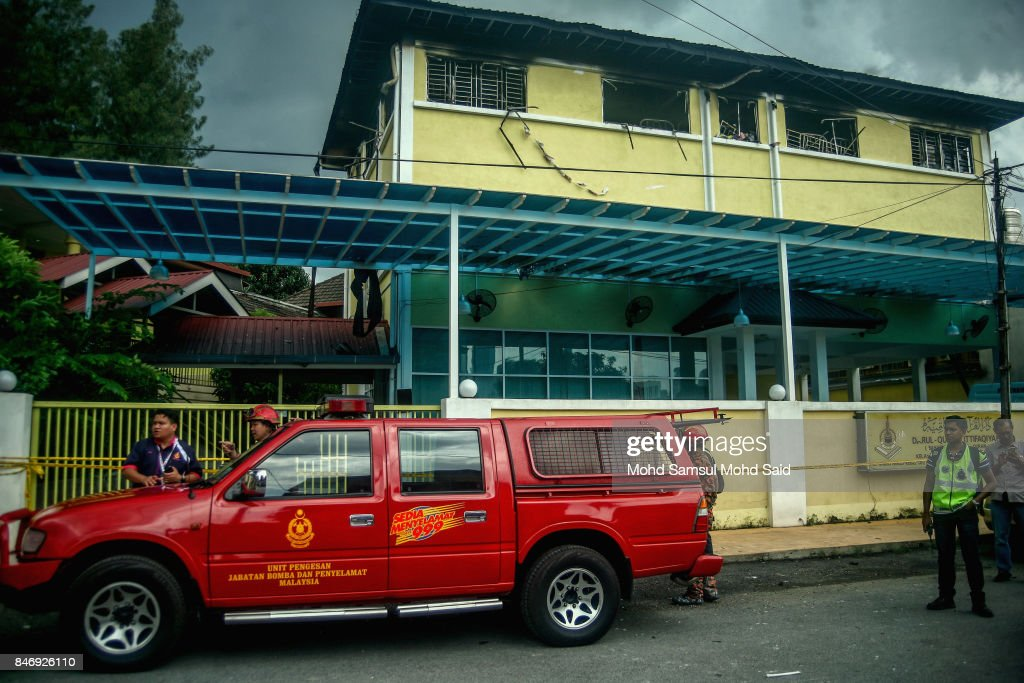 A Malaysia Fire and Rescue department are seen in front of the religious school Darul Quran Ittifaqiyah after a fire broke out on September 14, 2017 in Kuala Lumpur, Malaysia. A fire at a religious school Darul Quran Ittifaqiyah had killed at least 24 people including their religious teacher.