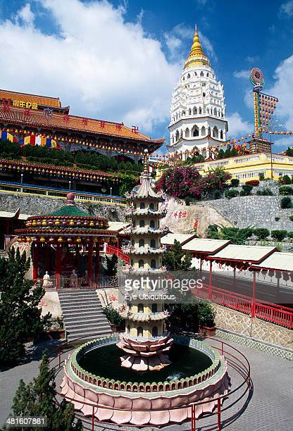 Malaysia Kek Lok Si Temple view of complex with Ban Po Pagoda of a Thousand Buddhas and circular pond with seven tiered pagoda sculpture