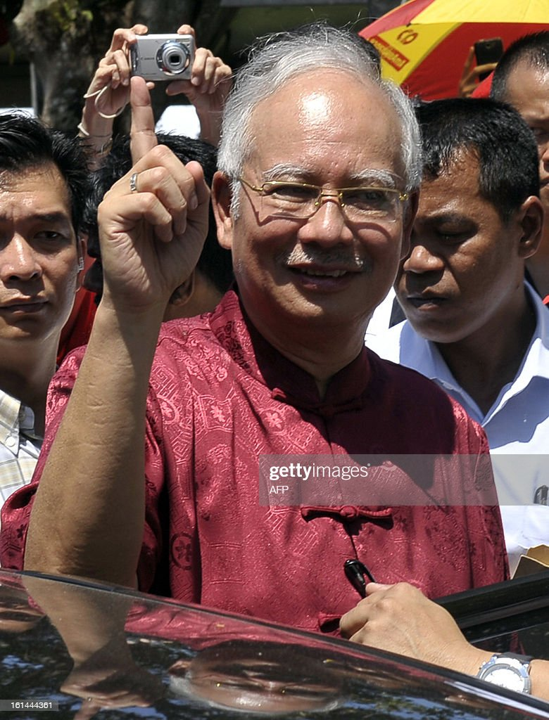 Malaysia Prime Minister Najib Razak gestures as he arrives to attend Chinese New Year celebrations on the northern island of Penang on February 11, 2013. South Korea's Psy performed his famous single'Gangnam Style' at an event organised by Malaysia's ruling coalition. Some 25 percent of Malaysia's 29 million people are ethnic Chinese and celebrate the Lunar New Year.