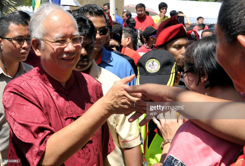 Malaysia Prime Minister Najib Razak meets people as he arrives to attend Chinese New Year celebrations on the northern island of Penang on February 11, 2013. South Korea's Psy performed his famous single'Gangnam Style' at an event organised by Malaysia's ruling coalition. Some 25 percent of Malaysia's 29 million people are ethnic Chinese and celebrate the Lunar New Year.