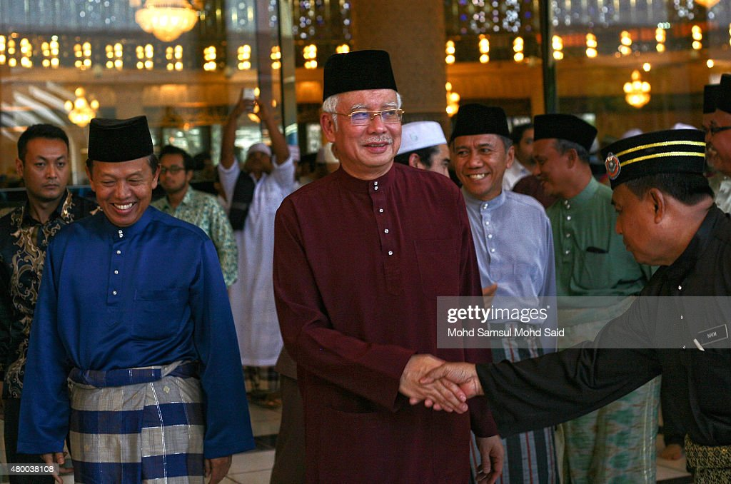 Malaysia Prime Minister Najib Razak shake hand with National mosque staff after leaves the special events on July 9, 2015 in Kuala Lumpur, Malaysia. Najib Razak is at the centre of a corruption inquiry, with allegations suggesting $700m were transferred to his personal bank accounts from a state investment fund. Authorities have raided the office of the fund as part of the investigation. Mr Najib strongly denies the allegations.