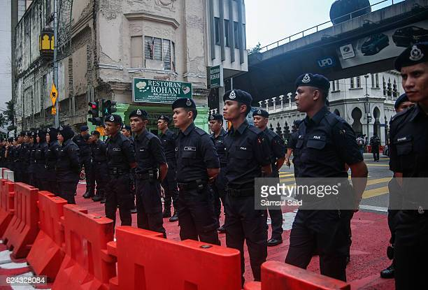 Malaysia Royal Police stand guard where the road is blocked to Independent Square during Bersih 50 protest for demanding Malaysia Prime Minister...