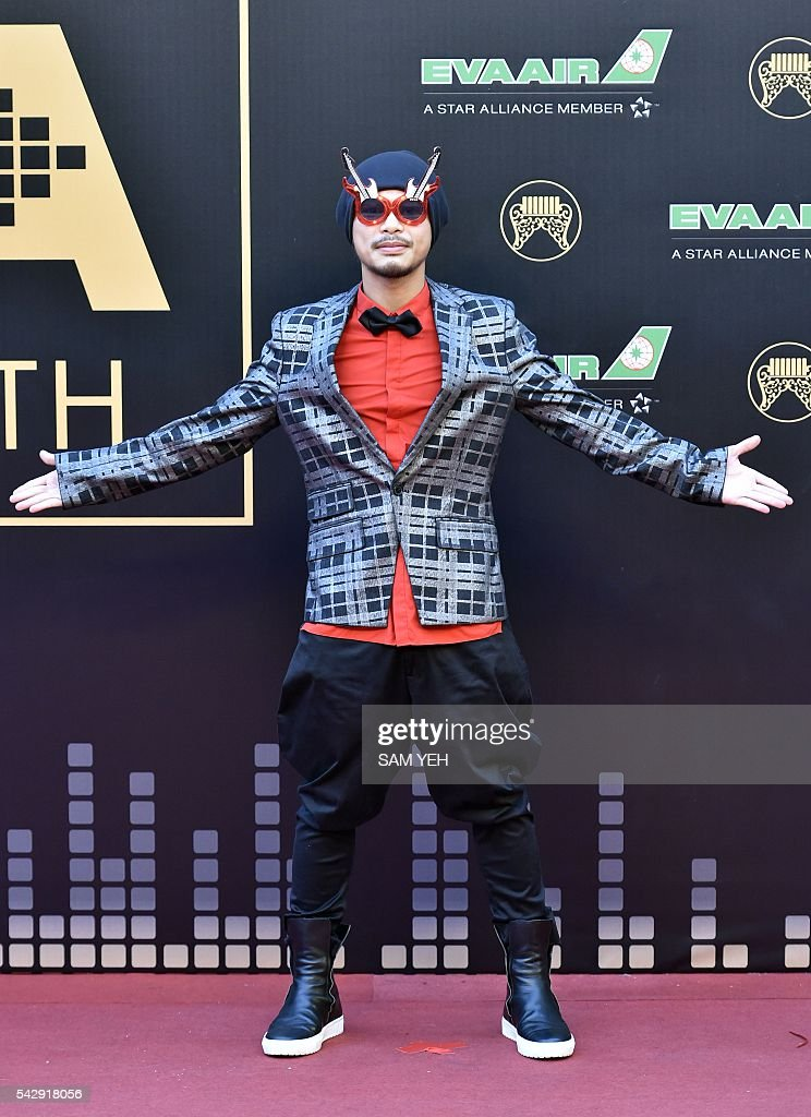 Malaysia singer Namewee arrives to attend the 27th Golden Melody Awards in Taipei on June 25, 2016. Some of Mandarin pop's biggest names have gathered for the annual Golden Melody music awards, with singers, songwriters and composers from Taiwan, China, Hong Kong, Singapore and Malaysia competing in more than 20 categories. / AFP / SAM YEH