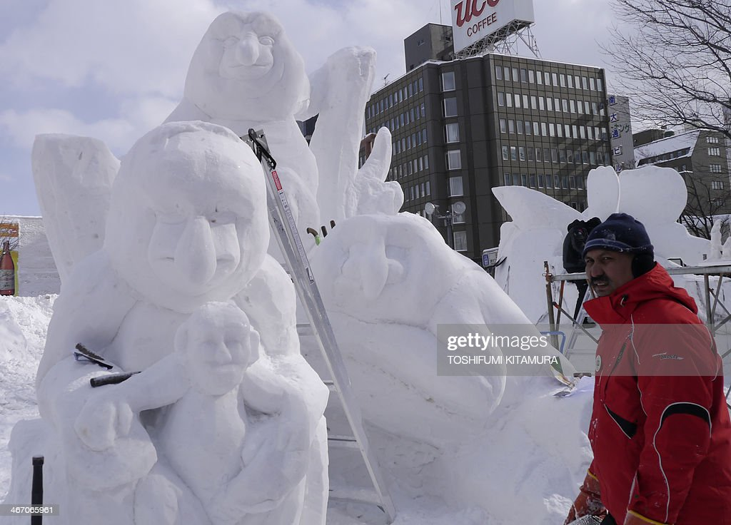 Malaysia team makes their snow sculpture entitled 'Proboscis Monkey' during the International snow statue contest at the 65th annual Sapporo Snow Festival in Sapporo on February 6, 2014. Nine foreign teams compete in the contest among some two million tourists expected to visit the week-long festival which started on Februrary 5. AFP PHOTO / TOSHIFUMI KITAMURA