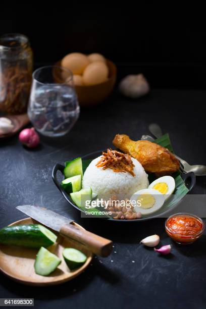 Malaysia traditional food 'Nasi lemak' and ingredients on rustic wooden table top.