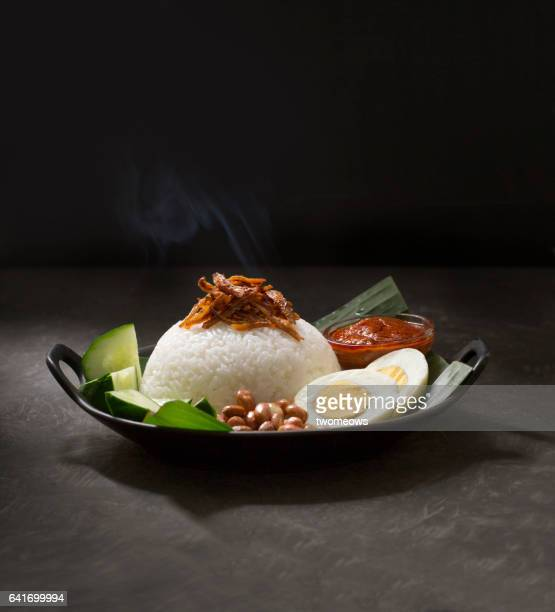 Malaysia traditional food 'Nasi lemak' on rustic wooden table top.