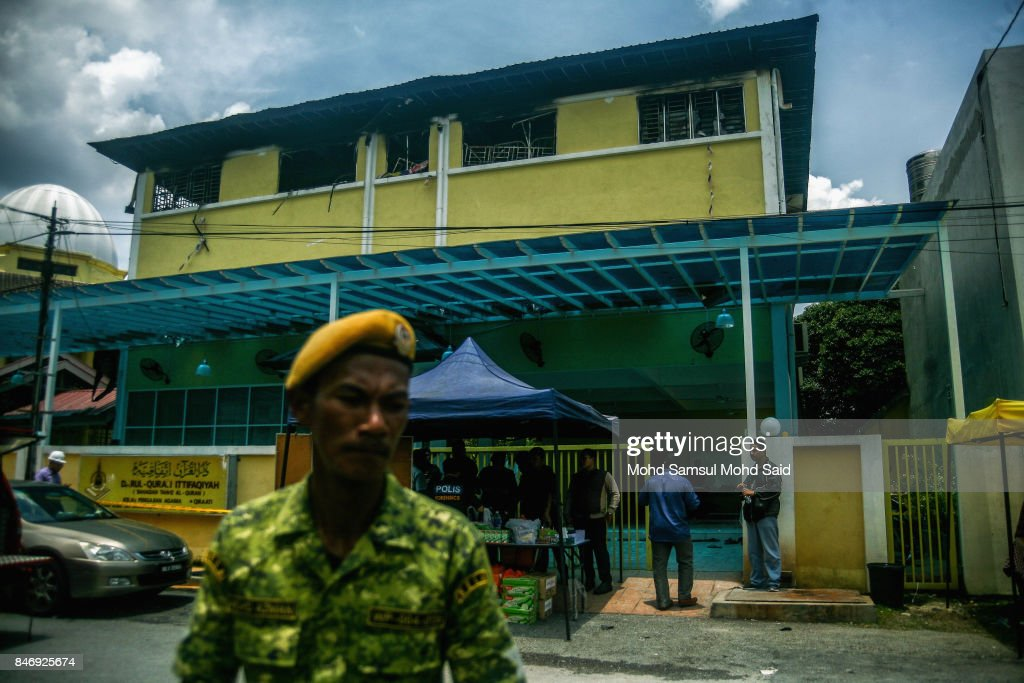 Malaysia volunteer deparment stand guard in front of the religious school Darul Quran Ittifaqiyah after a fire broke out on September 14, 2017 in Kuala Lumpur, Malaysia. A fire at a religious school Darul Quran Ittifaqiyah had killed at least 24 people including their religious teacher.