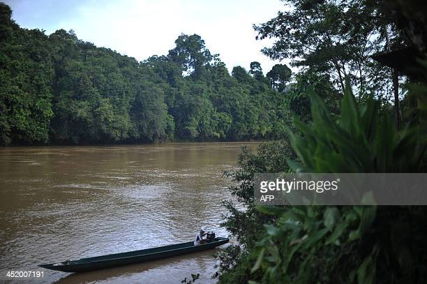 Malaysiacultureenvironmentnativerights energyFEATURE by Dan Martin This picture taken on November 18 2013 shows a villager man powering his boat near...