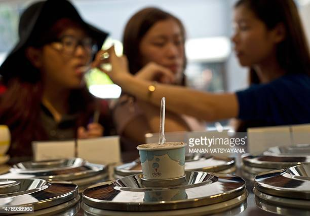 Malaysiafoodlifestylecuisine FEATURE by Satish Cheney In this picture taken February 28 2015 a gang of Malaysian girls enjoy a scoop of Nasi Lemak...