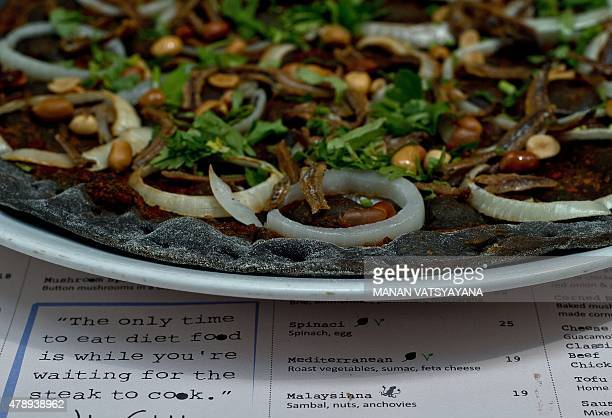 Malaysiafoodlifestylecuisine FEATURE by Satish Cheney In this picture taken April 6 2015 the Nasi Lemak pizza is served at the upscale Tujo Barserrie...