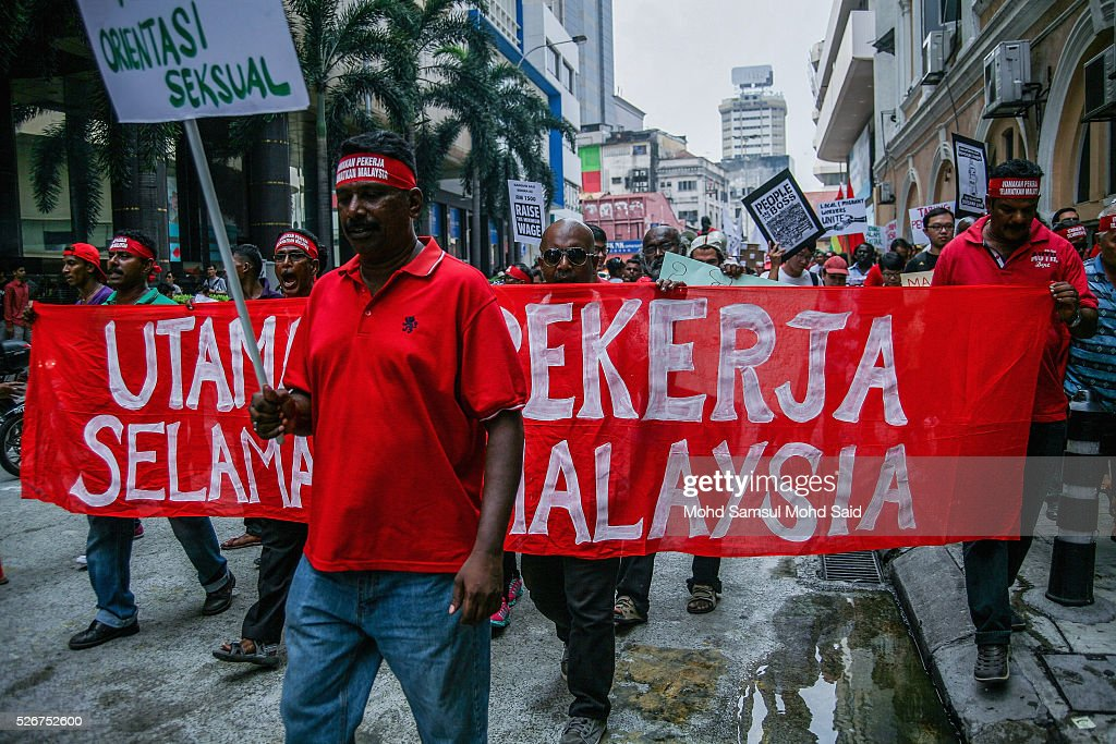Malaysian activist show a banner message during May Day Protest near shopping mall on May 1, 2016 in Kuala Lumpur, Malaysia. More than 70 NGOs and activist groups forming part of the Mayday were focusing on 'ordinary people' issues according to organizer. The May Day rally is focused on fighting for the rights of workers including a higher minimum wage of MYR1,500 (USD 389.00) amid the current economic situation in Malaysia and political issues like 1Malaysia Development Berhad (1MDB) and demanding the resignation of Prime Minister Najib Razak.