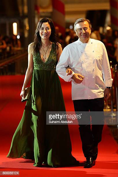 Malaysian actress Michelle Yeoh and French chef Daniel Boulud walk the red carpet during the Singapore International Film Festival Benefit Dinner Red...