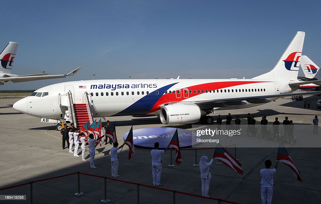 A Malaysian Airline System Bhd. (MAS) Boeing 737-800 aircraft stands in new livery at Kuala Lumpur International Airport (KLIA) in Sepang, Malaysia, on Thursday, Jan. 31, 2013. Malaysia Airlines joins the Oneworld airline alliance tomorrow. Photographer: Goh Seng Chong/Bloomberg via Getty Images
