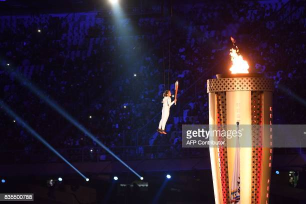 TOPSHOT Malaysian athlete Nur Davita lits the torch during the opening ceremony of the 29th Southeast Asian Games in Kuala Lumpur on August 19 2017 /...