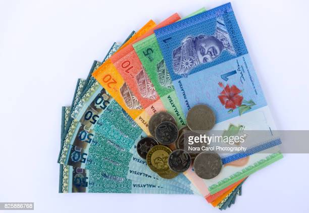 Malaysian Bank Notes and Coins On White Background