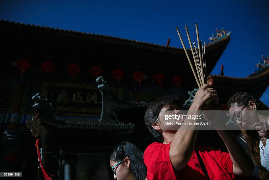 Malaysian- Chinese perform a prayer inside the Guan Yin temple during Lunar New Year of the monkey celebrations on February 8, 2016 outside Kuala Lumpur, Malaysia. According to the Chinese Calendar, the Lunar New Year which falls on February 8 this year marks the Year of the Monkey, the Chinese Lunar New Year also known as the Spring Festival is celebrated from the first day of the first month of the lunar year and ends with Lantern Festival on the Fifteenth day.
