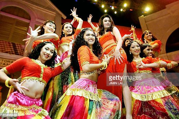 Malaysian dancers pose during a press preview of the musical 'Bollywood' at EVillage an entertainment village which is Malaysia's version of...