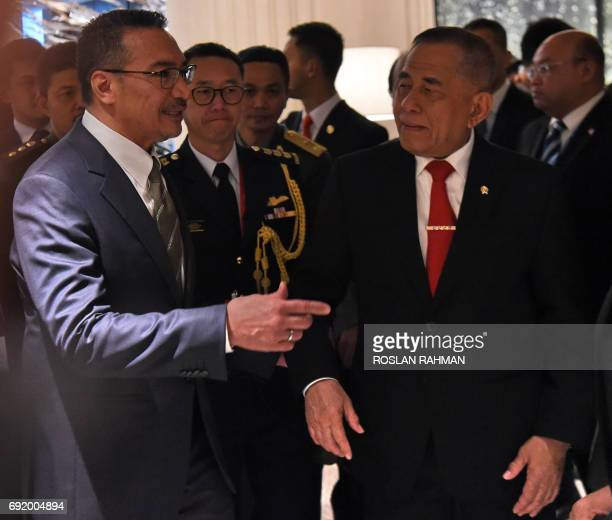 Malaysian Defence Minister Hishammuddin Tun Hussein and Indonesian Defense Minister General Ryamizard Ryacudu after attending a meeting between US...