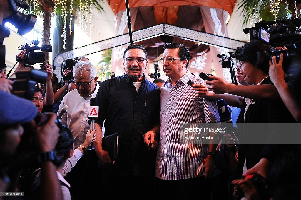 Malaysian Defense Minister <a gi-track='captionPersonalityLinkClicked' href=/galleries/search?phrase=Hishammuddin+Hussein&family=editorial&specificpeople=774002 ng-click='$event.stopPropagation()'>Hishammuddin Hussein</a> and Transport Minister <a gi-track='captionPersonalityLinkClicked' href=/galleries/search?phrase=Liow+Tiong+Lai&family=editorial&specificpeople=6262024 ng-click='$event.stopPropagation()'>Liow Tiong Lai</a> address the members of media on July 19, 2014 in Kuala Lumpur, Malaysia. Malaysia Airlines flight MH17 was travelling from Amsterdam to Kuala Lumpur when it crashed killing all 298 on board including 80 children. The aircraft was allegedly shot down by a missile and investigations continue over the perpetrators of the attack.