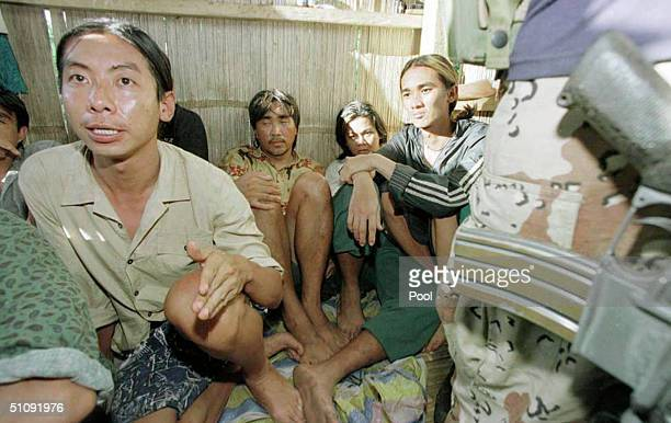 Malaysian Diving Instructor Ken Tong Left Talks To Reporters At The Kidnappers' Hideout On Jolo Island In The Southern Philippines May 1 2000 Three...