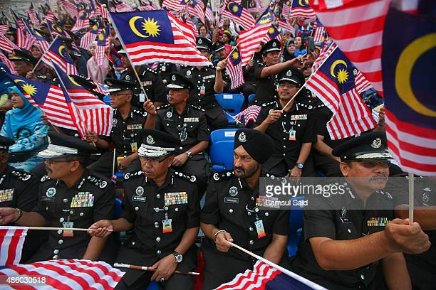 Malaysian firefighters wave Malaysia flags during the celebrations of 58th National Day celebrations at Merdeka Square on August 31 2015 in Kuala...