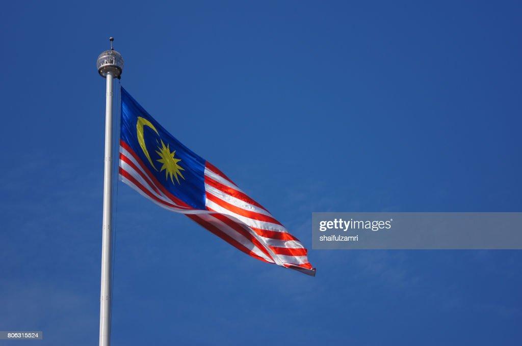 Malaysian flag waving in the wind : Stock Photo