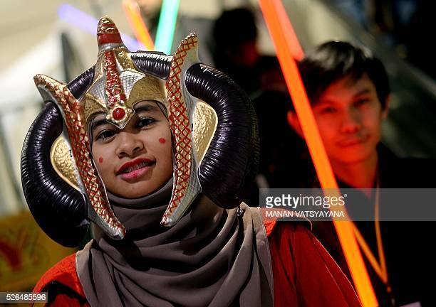 Malaysian Hanani Wan dressed as popular 'Star Wars 'character Queen Padm�� Amidala poses during an event to mark the Star Wars Day celebration in...
