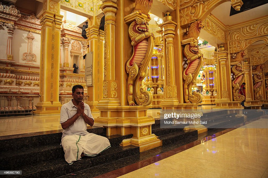 A Malaysian Hindu man prays inside a temple ahead of Diwali celebrationsr on November 9, 2015 in Kuala Lumpur, Malaysia. The Hindu community, which consists of eight percent of Malaysia's population of 26 million, will celebrate Diwali, the festival of lights on November 10, known locally as Deepavali.