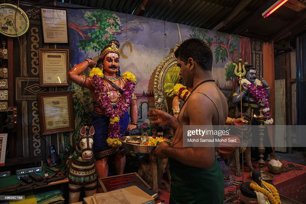 A Malaysian Hindu prays ahead of Diwali celebrationsr on November 9, 2015 in Kuala Lumpur, Malaysia. The Hindu community, which consists of eight percent of Malaysia's population of 26 million, will celebrate Diwali, the festival of lights on November 10, known locally as Deepavali.