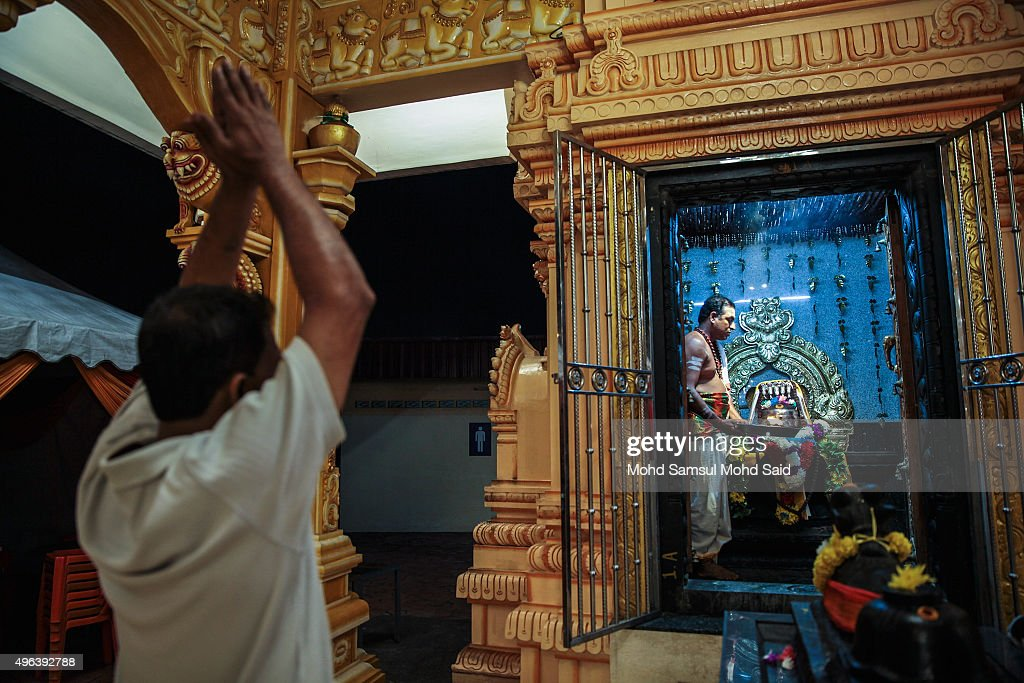 A Malaysian Hindu prays inside the temple ahead of Diwali celebrationsr on November 9, 2015 in Kuala Lumpur, Malaysia. The Hindu community, which consists of eight percent of Malaysia's population of 26 million, will celebrate Diwali, the festival of lights on November 10, known locally as Deepavali.