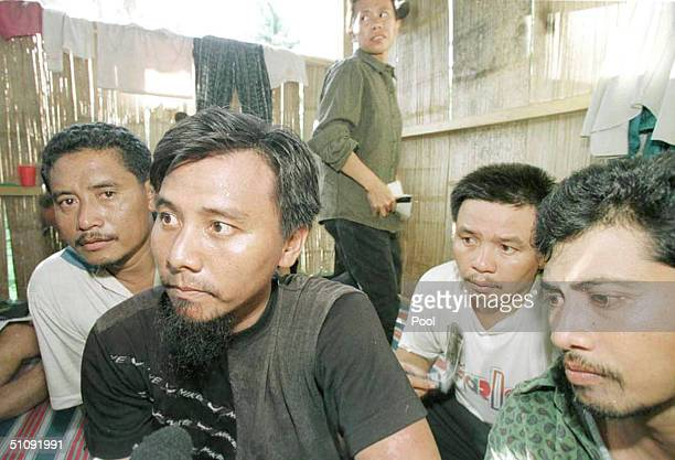 Malaysian Hostages Sit In A Shack At A Hideout On Jolo Island In The Southern Philippines May 1 2000 Three Journalists From International News...