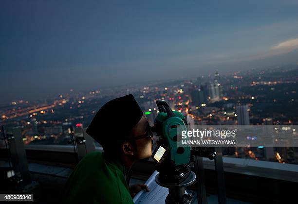 A Malaysian Islamic authority official performs the 'Rukyah Hilal Syawal' the sighting of the new moon to determine the Eid AlFitr celebrations in...