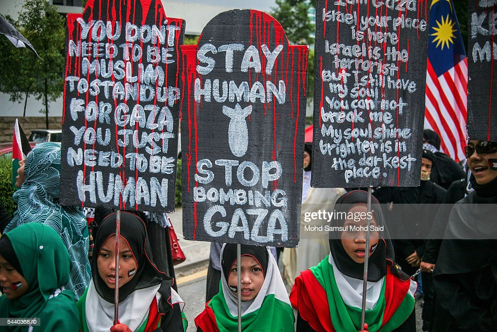 Malaysian Islamic childrens from Al-Quds Malaysia hold a placards in front of the United States Embassy during a demonstration on International Quds Day on July 1, 2016 in Kuala Lumpur, Malaysia. International Quds day is an annual event held on the last Friday of the Holy month of Ramadan, as a means to express solidarity with the Palestinians. Jordans Sate Minister for Media Affairs condemned the storming of the Al-Aqsa mosque by Israeli settlers and police, saying that such actions are a violation of international law.