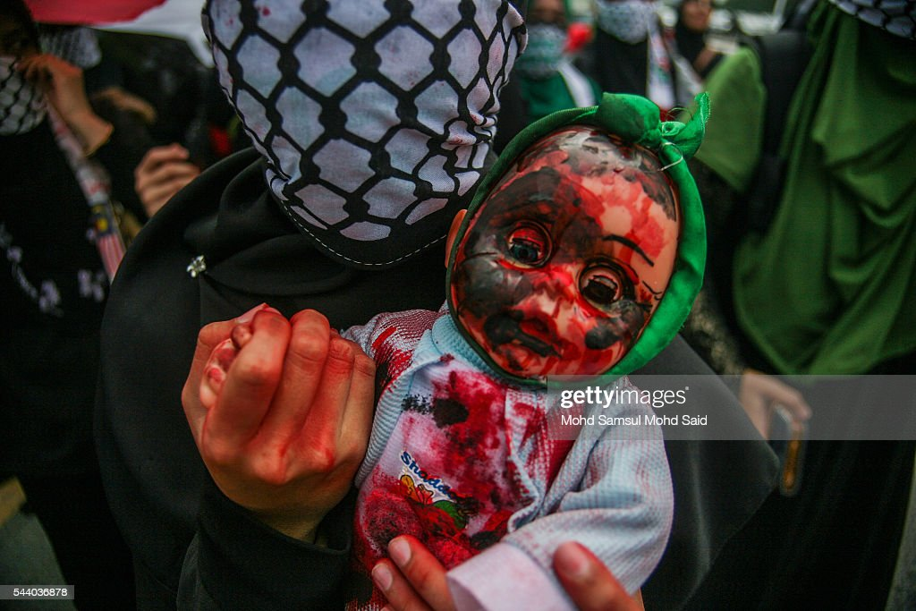 Malaysian Islamic NGO from Al-Quds Malaysia hold a dolls as a symbolic of Palestinian died in front of the United States Embassy during a demonstration on International Quds Day on July 1, 2016 in Kuala Lumpur, Malaysia. International Quds day is an annual event held on the last Friday of the Holy month of Ramadan, as a means to express solidarity with the Palestinians. Jordans Sate Minister for Media Affairs condemned the storming of the Al-Aqsa mosque by Israeli settlers and police, saying that such actions are a violation of international law.