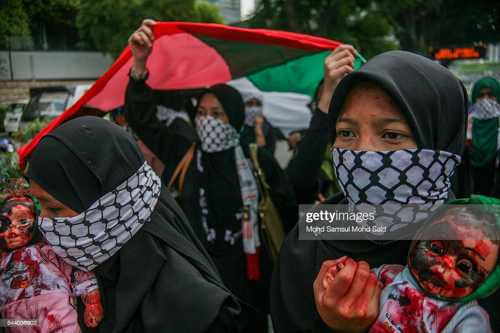 Malaysian Islamic NGO from Al-Quds Malaysia hold a dolls as a symbolic of Palestinian died in Al-Aqsa in front of the United States Embassy during a demonstration on International Quds Day on July 1, 2016 in Kuala Lumpur, Malaysia. International Quds day is an annual event held on the last Friday of the Holy month of Ramadan, as a means to express solidarity with the Palestinians. Jordans Sate Minister for Media Affairs condemned the storming of the Al-Aqsa mosque by Israeli settlers and police, saying that such actions are a violation of international law.