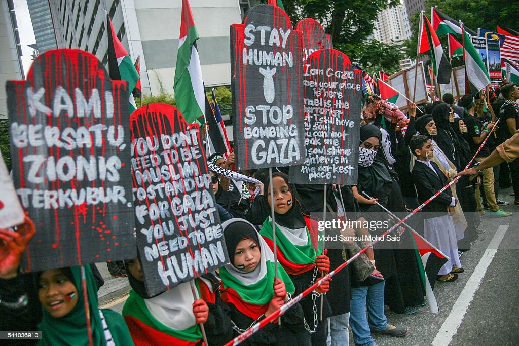 Malaysian Islamic NGO from Al-Quds Malaysia hold a placards in front of the United States Embassy during a demonstration on International Quds Day on July 1, 2016 in Kuala Lumpur, Malaysia. International Quds day is an annual event held on the last Friday of the Holy month of Ramadan, as a means to express solidarity with the Palestinians. Jordans Sate Minister for Media Affairs condemned the storming of the Al-Aqsa mosque by Israeli settlers and police, saying that such actions are a violation of international law.
