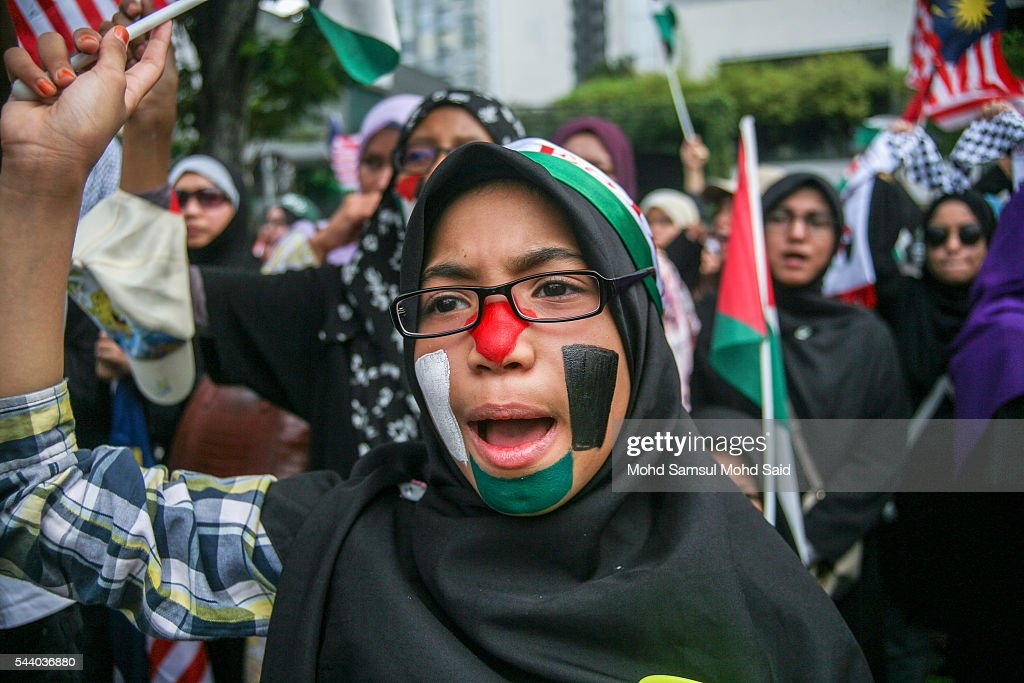 Malaysian Islamic NGO womens from Al-Quds Malaysia shout in front of the United States Embassy during a demonstration on International Quds Day on July 1, 2016 in Kuala Lumpur, Malaysia. International Quds day is an annual event held on the last Friday of the Holy month of Ramadan, as a means to express solidarity with the Palestinians. Jordans Sate Minister for Media Affairs condemned the storming of the Al-Aqsa mosque by Israeli settlers and police, saying that such actions are a violation of international law.