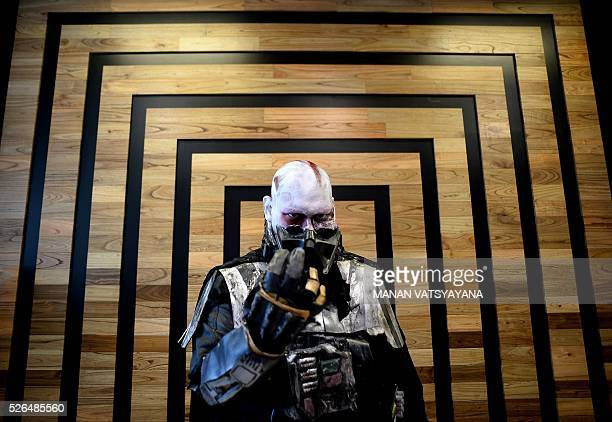 Malaysian Khalil Ishak dressed as Darth Vader poses during an event to mark the Star Wars Day celebration in Kuala Lumpur on April 30 2016 AFP PHOTO...