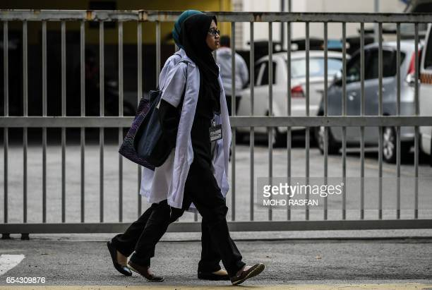 Malaysian medical students walk past the forensics wing of the Hospital Kuala Lumpur where the body of Kim JongNam is being held in Kuala Lumpur on...